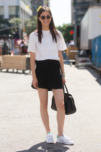How to wear: white crew-neck t-shirt, black shorts, white leather low top sneakers, black leather tote bag