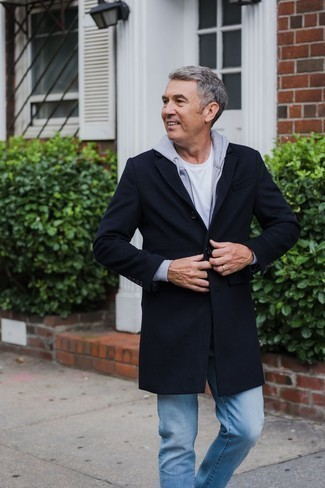 Men's Looks & Outfits: What To Wear In 2020: Wear a navy overcoat and light blue jeans and you'll pull together a sleek and classy look.