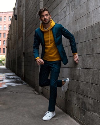 How to wear: white leather low top sneakers, white crew-neck t-shirt, mustard hoodie, navy suit