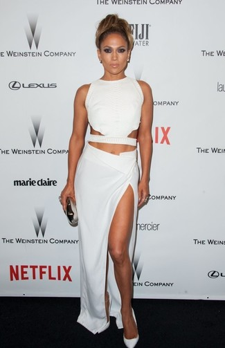 Jennifer Lopez wearing White Cutout Cropped Top, White Slit Maxi Skirt, White Leather Pumps, Silver Clutch