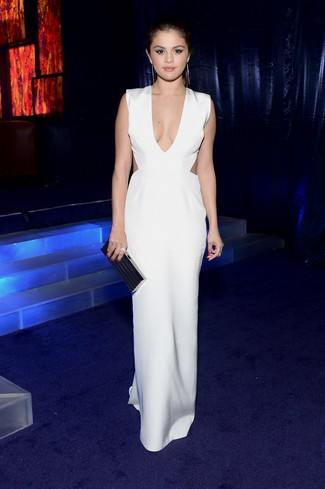 Selena Gomez wearing White Cutout Maxi Dress, Black Clutch