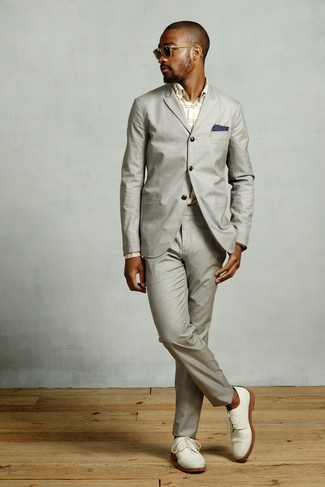 How to Wear White Suede Derby Shoes: A grey suit and a beige plaid dress shirt are absolute wardrobe heroes if you're crafting an elegant wardrobe that matches up to the highest sartorial standards. White suede derby shoes act as the glue that will bring your look together.