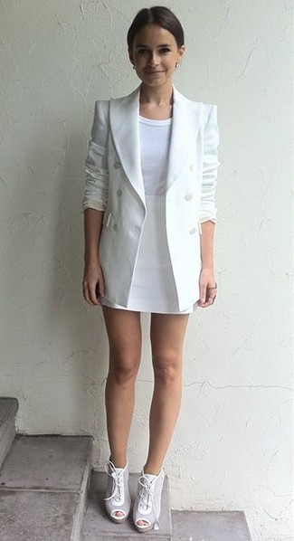 Miroslava Duma wearing White Double Breasted Blazer, White Crew-neck T-shirt, White Mini Skirt, White Leather Lace-up Ankle Boots