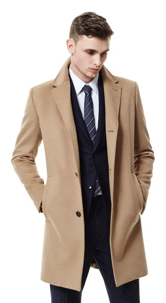 How to wear: charcoal vertical striped tie, white dress shirt, black vertical striped suit, camel overcoat