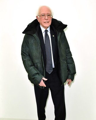 Bernie Sanders wearing Black and White Print Tie, White Dress Shirt, Black Suit, Dark Green Puffer Jacket