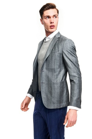 How to wear: navy vertical striped dress pants, white dress shirt, grey crew-neck sweater, grey vertical striped blazer