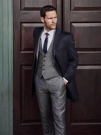 How to wear: red and navy tie, white dress shirt, grey three piece suit, black overcoat