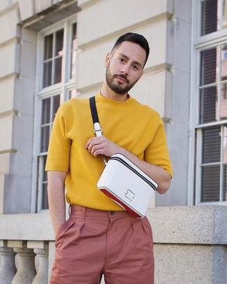 How to wear: white fanny pack, pink chinos, mustard knit crew-neck t-shirt