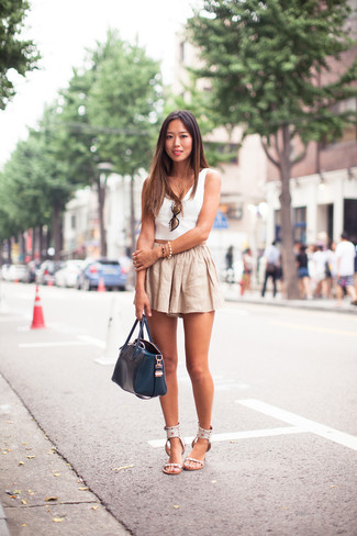 How to wear: navy leather tote bag, white leather flat sandals, beige linen shorts, white cropped top