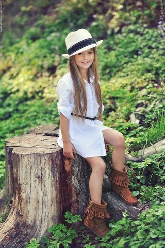 How to Wear Brown Uggs For Girls: Go for a sophisticated look for your little girl with white dress. This look is complemented well with brown uggs.