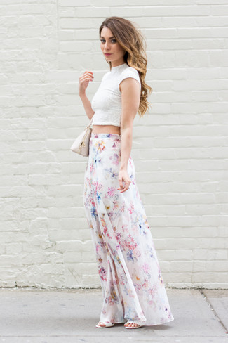 How to wear: beige leather handbag, white leather heeled sandals, white floral maxi skirt, white lace cropped top