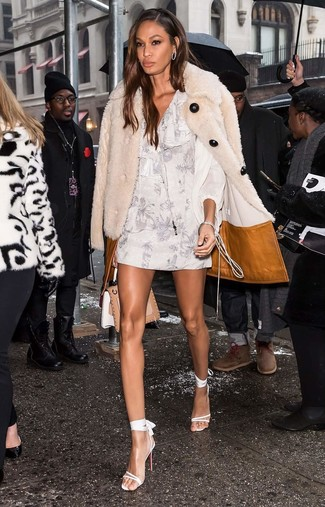 How to wear: tan leather satchel bag, white leather heeled sandals, white floral shift dress, beige fur coat