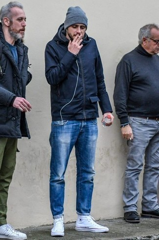 How to Wear a Navy Parka For Men: Nail the effortlessly stylish outfit by wearing a navy parka and blue jeans. A pair of white canvas high top sneakers acts as the glue that will pull this outfit together.