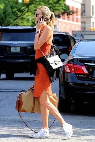How to wear: black leather satchel bag, white canvas high top sneakers, orange bodycon dress, black crew-neck sweater