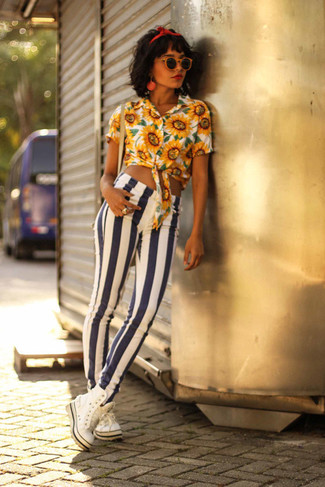 How to wear: red headband, white high top sneakers, white and navy vertical striped skinny jeans, yellow floral button down blouse
