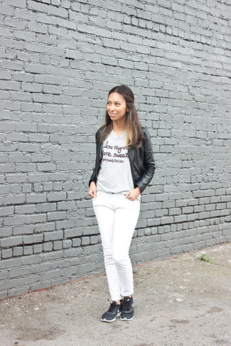 How to wear: black athletic shoes, white jeans, grey print crew-neck t-shirt, black leather bomber jacket