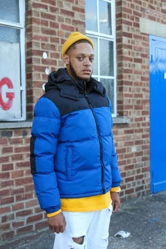 How to wear: yellow beanie, white ripped jeans, yellow sweatshirt, blue puffer jacket