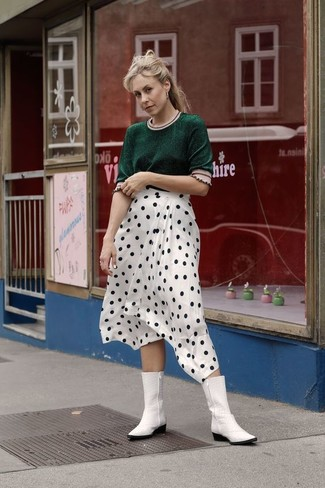 How to Wear White Leather Cowboy Boots For Women: If you're facing a fashion situation where comfort is critical, this pairing of a dark green short sleeve sweater and a white and black polka dot midi skirt is a no-brainer. Go off the beaten track and jazz up your look by rocking a pair of white leather cowboy boots.