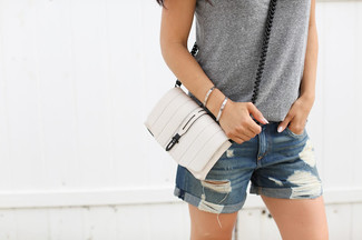 How to wear: white leather crossbody bag, blue ripped denim shorts, grey tank