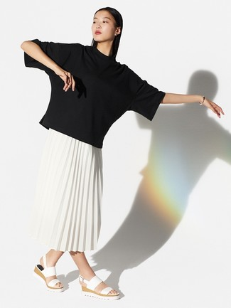 How to wear: white leather flat sandals, white pleated midi skirt, black crew-neck t-shirt