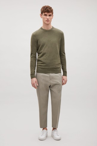 How to wear: white leather low top sneakers, beige dress pants, olive crew-neck sweater