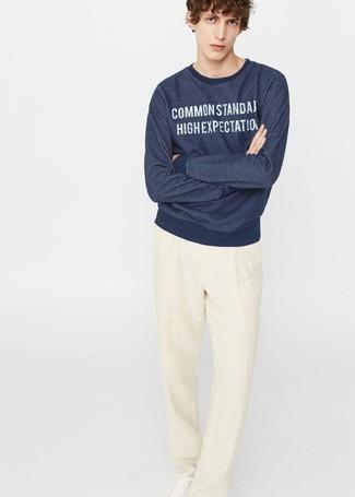 How to wear: white leather low top sneakers, beige linen dress pants, navy print sweatshirt