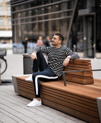 How to wear: white leather low top sneakers, black and white sweatpants, black and white horizontal striped long sleeve t-shirt