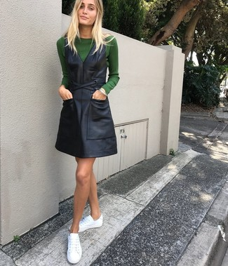 How to wear: white leather low top sneakers, black leather overall dress, dark green crew-neck sweater
