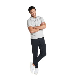 How to wear: white leather low top sneakers, black sweatpants, grey polo