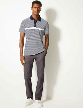 How to wear: white leather low top sneakers, charcoal chinos, navy and white horizontal striped polo