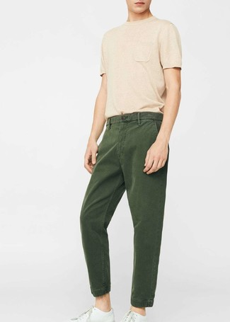 How to wear: white leather low top sneakers, dark green chinos, tan crew-neck t-shirt