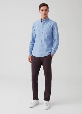 How to Wear a Light Blue Long Sleeve Shirt For Men: This relaxed combination of a light blue long sleeve shirt and dark purple chinos is super easy to throw together in seconds time, helping you look sharp and ready for anything without spending too much time digging through your wardrobe. Finishing off with a pair of white leather low top sneakers is a guaranteed way to introduce a more laid-back spin to your look.
