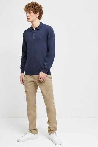 How to wear: white leather low top sneakers, khaki chinos, navy polo neck sweater