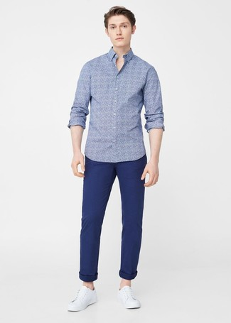 How to wear: white leather low top sneakers, navy chinos, blue floral long sleeve shirt
