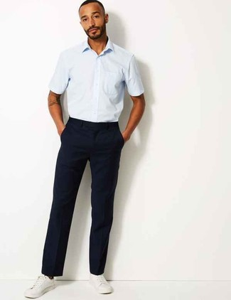 How to wear: white leather low top sneakers, navy chinos, light blue short sleeve shirt