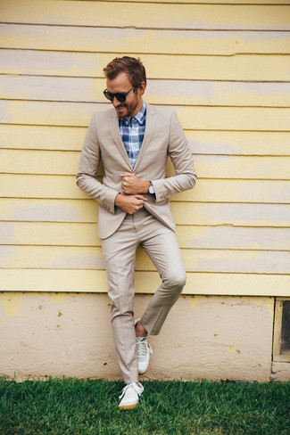 How to wear: white leather low top sneakers, navy plaid dress shirt, beige suit