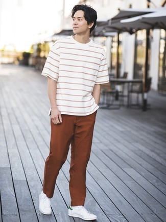 How to wear: white leather low top sneakers, tobacco chinos, white and red horizontal striped crew-neck t-shirt