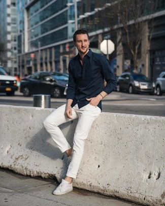 How to wear: white leather low top sneakers, white jeans, black long sleeve shirt