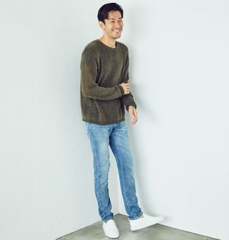 How to Wear an Olive Crew-neck Sweater For Men: To create an off-duty ensemble with a modernized spin, go for an olive crew-neck sweater and light blue jeans. When it comes to shoes, complement your look with white leather slip-on sneakers.