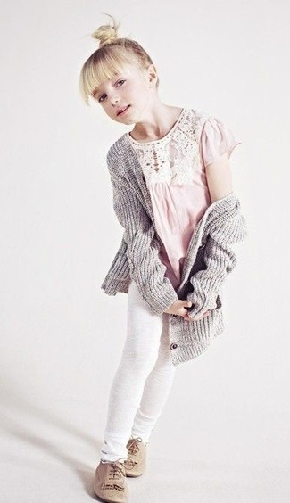 How to Wear Beige Oxford Shoes For Girls: Suggest that your child pair a grey cardigan with white leggings for a comfy outfit. This ensemble is complemented nicely with beige oxford shoes.