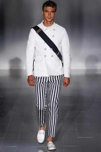 How to wear: black canvas messenger bag, white leather loafers, black and white vertical striped chinos, white military jacket