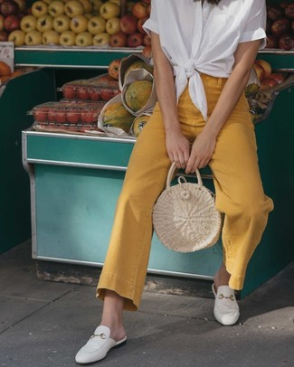 How to wear: beige straw tote bag, white leather loafers, mustard flare jeans, white short sleeve button down shirt