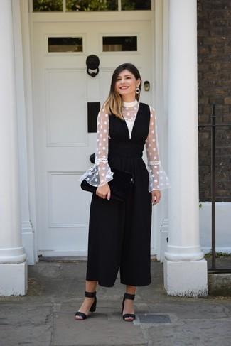 How to wear: white polka dot long sleeve blouse, black jumpsuit, black suede heeled sandals, black earrings