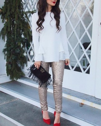 This pairing of a white ruffle long sleeve blouse and gold sequin skinny pants is super versatile and really up for any sort of adventure you may find yourself on. Red suede pumps will become an ideal companion to your style. We promise this outfit is the answer to all of your transeasonal wear problems.