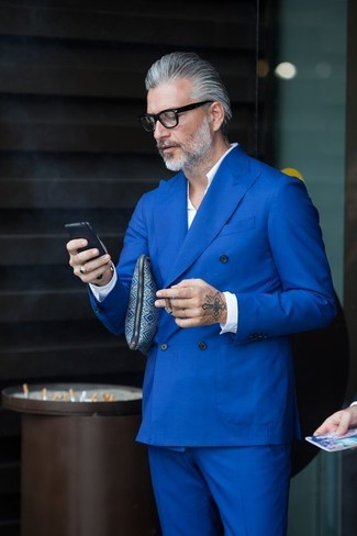 For polished style with a contemporary spin, wear a blue suit with a white long sleeve shirt.