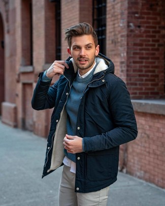 How to wear: grey chinos, white long sleeve shirt, teal crew-neck sweater, navy parka