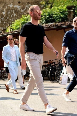 Men's Looks & Outfits: What To Wear In 2020: You'll be surprised at how easy it is for any guy to pull together this relaxed casual ensemble. Just a black crew-neck t-shirt worn with beige chinos. A pair of white canvas low top sneakers can integrate seamlessly within a great deal of looks.