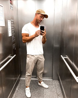 How to wear: tan baseball cap, white low top sneakers, beige chinos, white crew-neck t-shirt