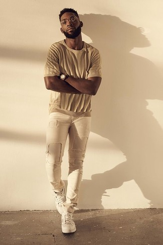How to wear: brown watch, white low top sneakers, beige ripped skinny jeans, tan crew-neck t-shirt