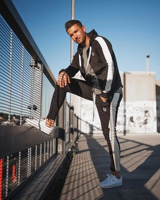 How to wear: white low top sneakers, black and white track suit, grey crew-neck t-shirt